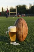 Football and beer — Stock Photo
