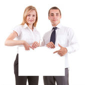 Business couple with advert board — Stock Photo