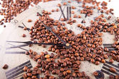 Coffee beans scattered on a clock — Stock Photo