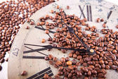 Picture of coffee beans on a vintage clock — Stock Photo