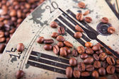 Vintage clock and coffee beans — Stock Photo