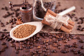 Coffee with spices on a burlap background — Stock Photo