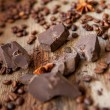 Stock Photo: Chocolate and coffee on wooden background