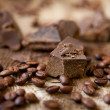 Stock Photo: Coffee and chocolate on wooden background