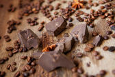 Chocolate and coffee on a wooden background — Stock Photo