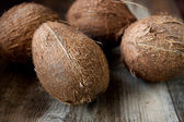 Coconuts on a old wooden board — Stock Photo