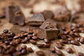 Kawy i czekolady na tle drewniane — Zdjęcie stockowe