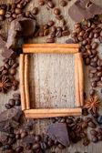 Frame of cinnamon sticks, coffee and chocolate — Stock Photo