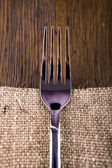 Fork on a rustic wooden background — Stock Photo