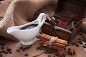 White gravy boat with cinnamon and chocolate — Stock Photo