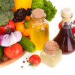 Stock Photo: Vegetables and few vessels with oil