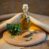 Mustard oil in a vessel with seeds — Stock Photo