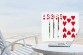 Royal Flush pouring out from laptop — Stock Photo