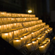 Church candles in Notre Dame de Paris — Stock Photo