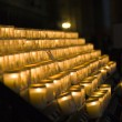 Stock Photo: Church candles in Notre Dame de Paris