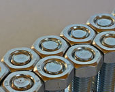 Two rows of bolts and nuts — Stock Photo