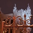 Royalty-Free Stock Photo: House with chimaeras through the fence