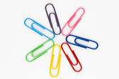 Colorful paper clips in white background — Stock Photo