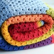 Rainbow crocheted blanket — Stock Photo #23559577