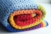 Rainbow crocheted blanket — Stock Photo