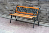 Wooden bench in a park — Stock Photo