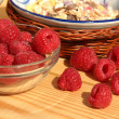 Fresh raspberry in a basket on wooden table  — Stock Photo