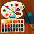 Box of watercolors on wooden desk  — Stock Photo