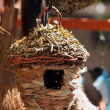 Straw and wooden birdhouse — Stock Photo