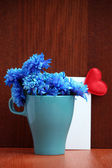 Beautiful bouquet of bright flowers in color mug — Стоковое фото