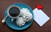 Heart message and cup of coffee — Stock Photo