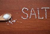 Sea salt in wooden wpoon — Stockfoto