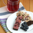 Muesli snack bar, blueberries and berry tea — Stock Photo #40215123