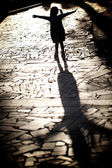 Silhouette girl playing in the sun — Stock Photo