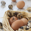 Eggs in nest on the table — Stock Photo