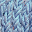 Nautical ropes twisted with knots - Stock Photo