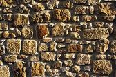 Tło ściany skał teksturowanej piasek — Zdjęcie stockowe