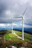 Windmill farm in mountain with beautiful light — Stock Photo