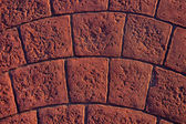 Background with textured cobbles on walkway — Stock Photo