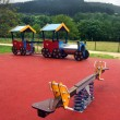 Seesaw and train on playground for children — Stock Photo