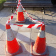 Danger cones with caution tape — Stock Photo