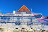 House facade restoration with scaffolding — Stock Photo