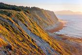 Cliffs of Azkorri beach at sunset — Stock Photo