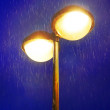Lampost at night with rain — Stock Photo