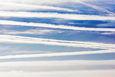 Airplane trails and lines in blue sky — Stock Photo