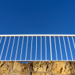 Stock Photo: White railing against blue sky