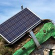 Solar panel on old cabin roof — Stock Photo