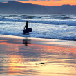 Stock Photo: Surfer with boogie board at sunset
