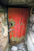 Old and abandoned house door — Foto Stock