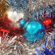Background with christmas ball and tinsel — Stock Photo