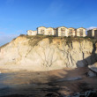 Houses on cliff near the sea — Stock Photo